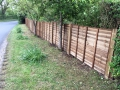 Replacement larch lap panel fencing
