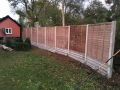 Panel fencing and concrete retaining walls